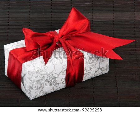 Gift box with red bow - stock photo
