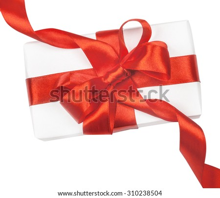Gift box with red ribbon and bow isolated on the white background - stock photo