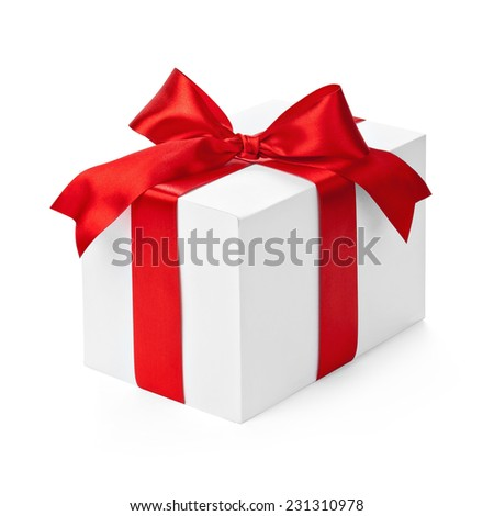 Gift box with red ribbon and bow isolated on white - stock photo