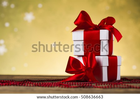 Gift box with red ribbon bow on Christmastime celebration