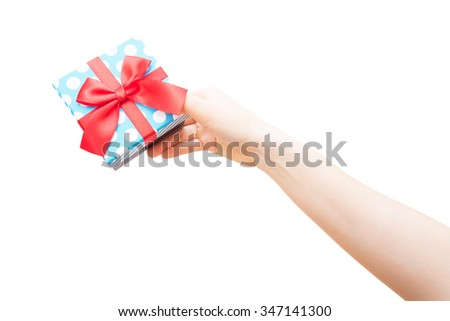 gift box with red ribbon in hand on white background - stock photo