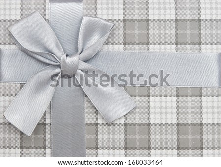 gift box with silver ribbon and bow isolated on white background, top view  - stock photo