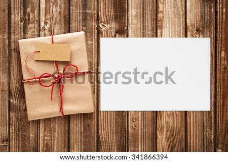 Gift box with tag and blank greeting card - stock photo