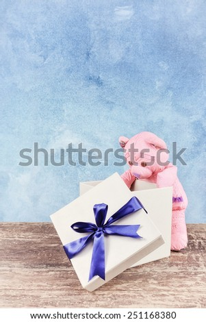 Gift box with teddy bear - stock photo