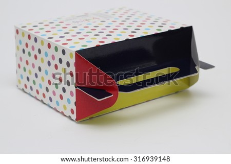 gift box with white polka dots, isolated on white