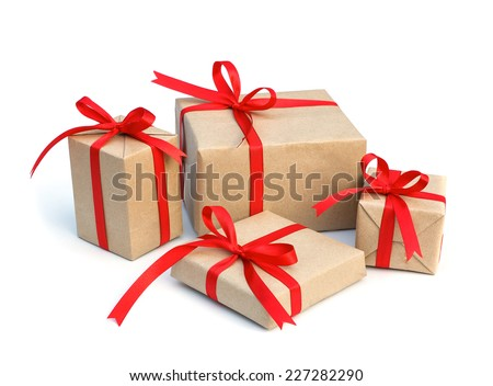 gift box wrap brown paper with red ribbon and isolated background - stock photo