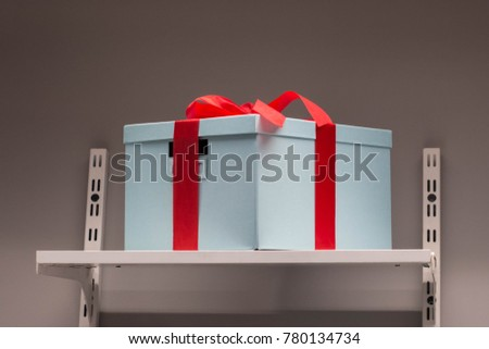 Gift box wrapped in color paper with ribbon bow.
