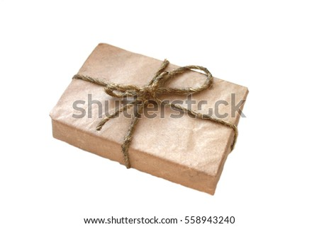 gift box wrapped in paper and wrapped with rope on a white background clouded sky