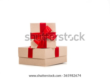 Gift box wrapped in recycled paper with red ribbon  - stock photo