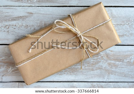 Gift box wrapped with brown paper - stock photo