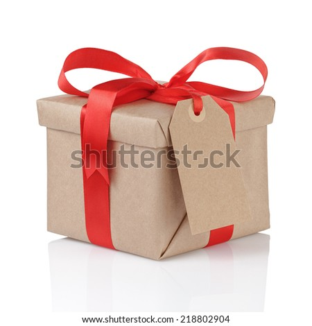 gift box wrapped with kraft paper and red bow with tag for text, isolated - stock photo