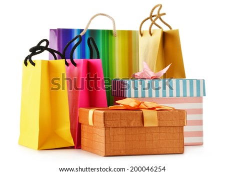 Gift boxes and colorful gift bags isolated on white background. - stock photo