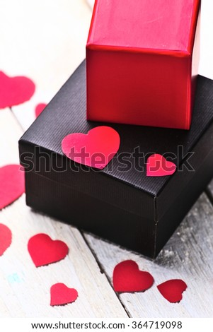 Gift boxes and heart paper cut on white wooden background. Valentines day. - stock photo
