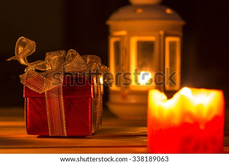 Gift boxes are placed with candles