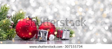 Gift boxes,ball and fir branch on abstract background