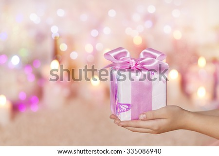 Gift Boxes Holding on Hands, Giving Present Pink Silk Ribbon Bow for Girl or Woman - stock photo