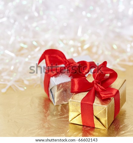 Gift boxes on reflective golden and shiny white background