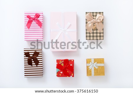 Gift boxes on white background top view. Wedding invitation, greeting card for Mother's Day. Beautiful birthday invitation. Selective focus. - stock photo