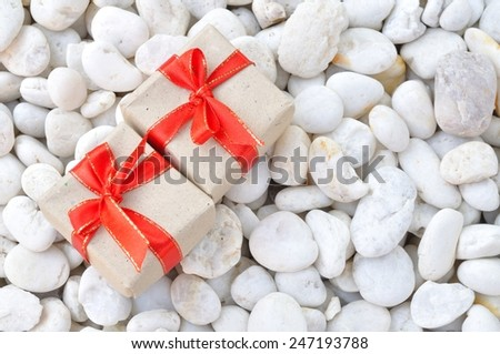 gift boxes on white stone background  - stock photo
