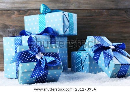 Gift boxes on wooden background - stock photo