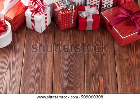 Gift boxes on wooden table. View with copy space