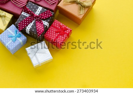 Gift boxes on yellow background - stock photo
