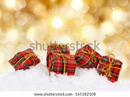 Gift boxes over golden background - stock photo