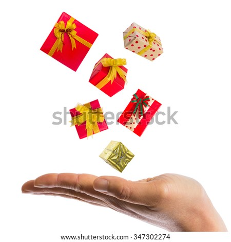 gift boxes over hand on white background - stock photo
