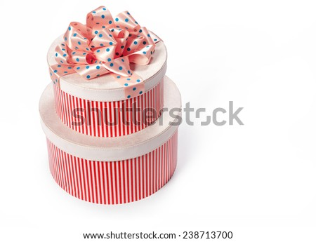 Gift boxes with a bow. Wedding & Happy Birthday concept / studio photo of red and white box wrapping ribbon with bowknot - on white background  - stock photo