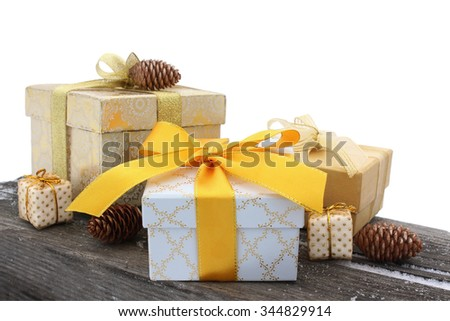 Gift boxes with bows and fir cones on an old wooden background isolated on a white background - stock photo
