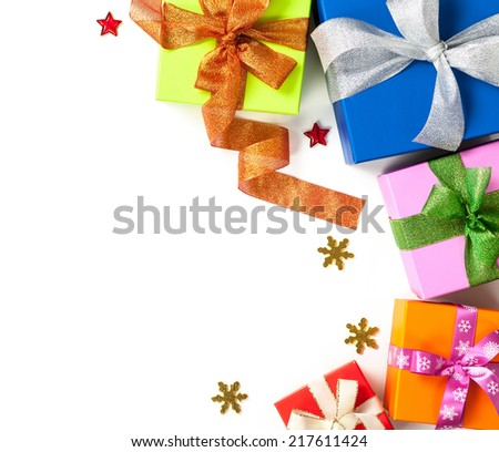 Gift boxes with bows on white background. Christmas composition with copy space. Top view - stock photo
