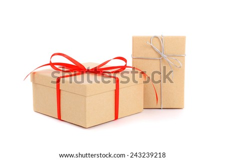 gift boxes with red and silver bows - stock photo