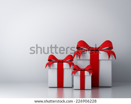 Gift boxes with red ribbon bow and empty white wall background abstract - stock photo