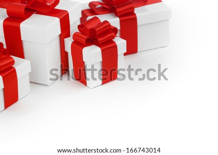 Gift boxes with red ribbon bows on white background