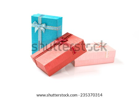 Gift  boxes  with  ribbon and bow isolated on the white, clipping path included - stock photo