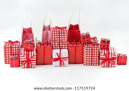 Gift boxes with xmas presents wrapped in red paper with ornament on white background - stock photo