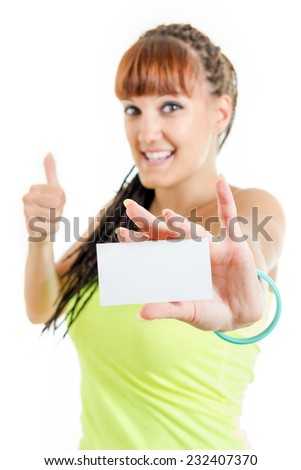 Gift card , excited cute smiling woman or teenager girl showing empty blank paper card sign with copy space for text with thumbs up . Gorgeous caucasian female model isolated on white background - stock photo