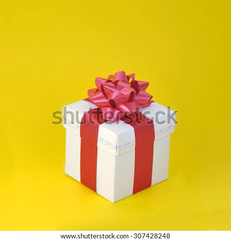 gift close up isolated on yellow background  - stock photo