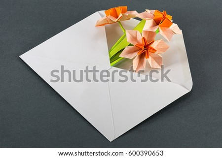 Gift envelope white origami narcissus on stock photo 600390653 gift envelope with white origami narcissus on dark grey background mightylinksfo Choice Image