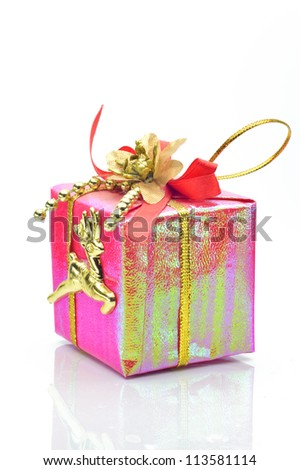 Gift for Christmas on a white background close-up - stock photo