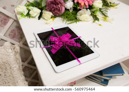 Gift for the holidays tablet with a bow