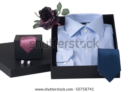 gift idea, men's shirt and choice of ties in elegant box, isolated, selective focus - stock photo
