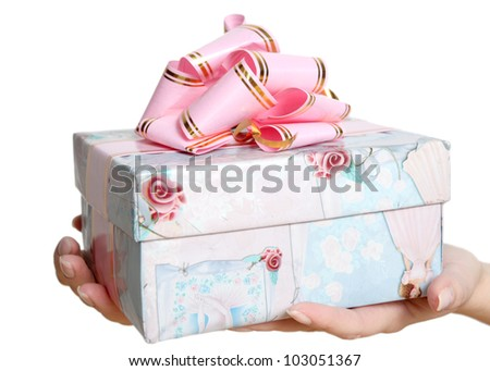gift in female hands on a white background