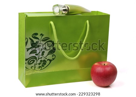 Gift in green wrapping isolated on white background - stock photo