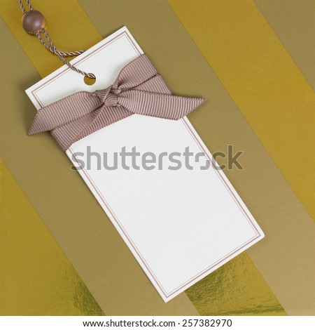 Gift label on a gold box - stock photo