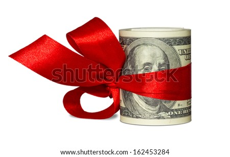 Gift of money. Stack of dollar bills with red ribbon isolated on white background.  - stock photo