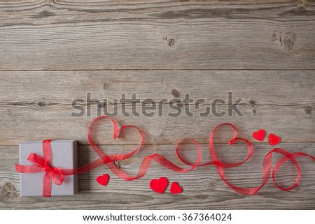 Gift on Valentine's Day, red hearts ribbon