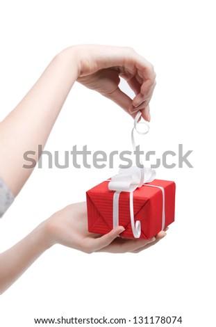 Gift opening, isolated on white - stock photo