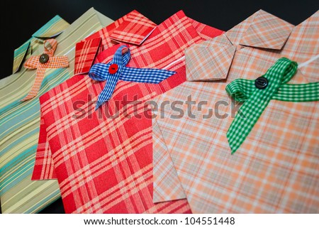 Gift pack of different papers, in the form of a shirt. Located diagonally. Close-up. - stock photo