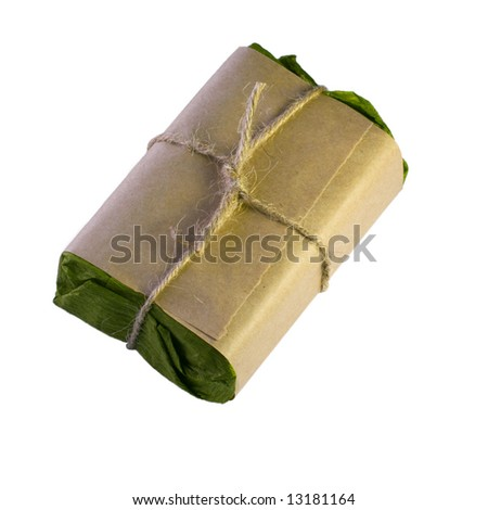 Gift packaged in green and brown paper isolated on white background